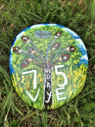 photo of rock painted with a tree