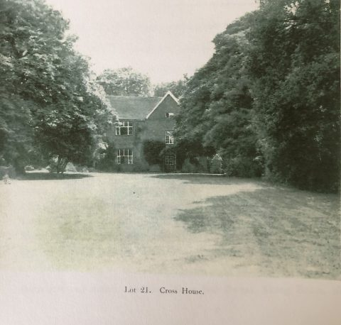 old photo showing a house at the back of a large lawn