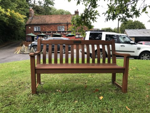 photo of wooden bench that has been restrained