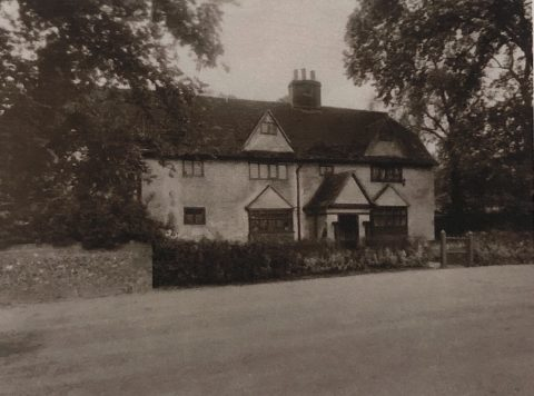 old photo showing an old farmhouse