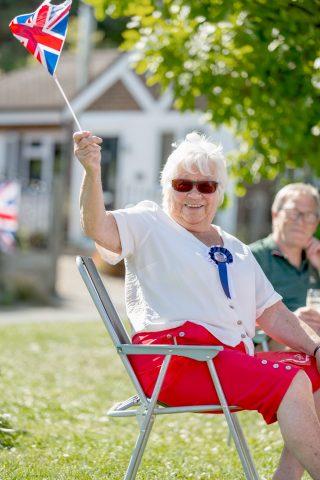 woman waving a Union Jack