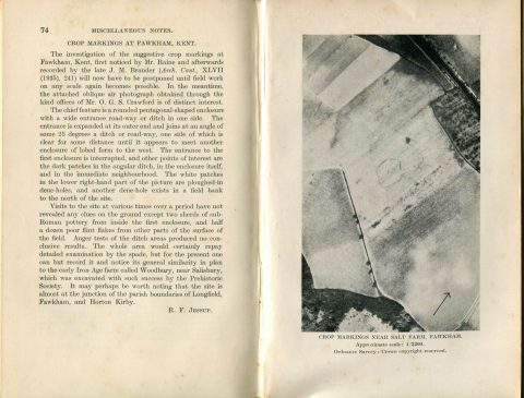 pages of an old book showing an aerial photo with a crop marking in the shape of a banjo