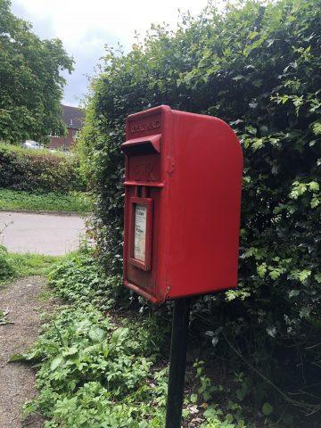 shiny red post box