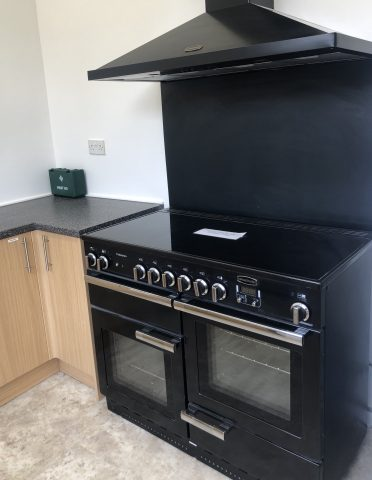 black cooker with hood