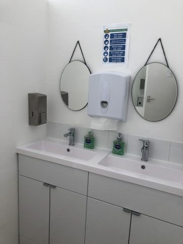 Two basins with mirrors over them in ladies loo