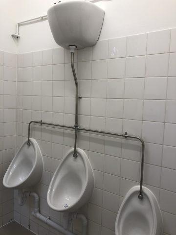 three urinals in gents loo