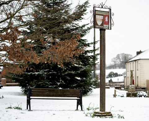 village sign in snow